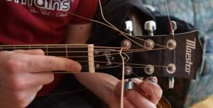 tightening strings on lap